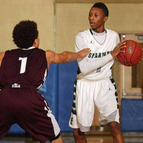 Elmont's Keith Tompkins, right, looks to pass around