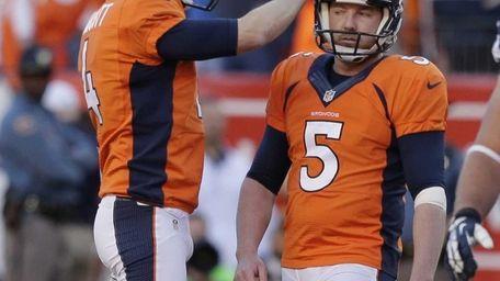 Denver Broncos punter Britton Colquitt congratulates Denver Broncos