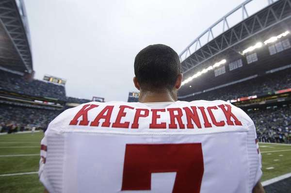 San Francisco 49ers' Colin Kaepernick waits for the