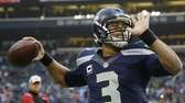 Seattle Seahawks quarterback Russell Wilson warms up before