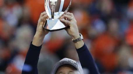 Denver Broncos head coach John Fox celebrates with