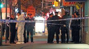 Police are shown in hazmat gear outside 90-20