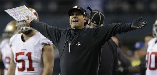 San Francisco 49ers head coach Jim Harbaugh reacts