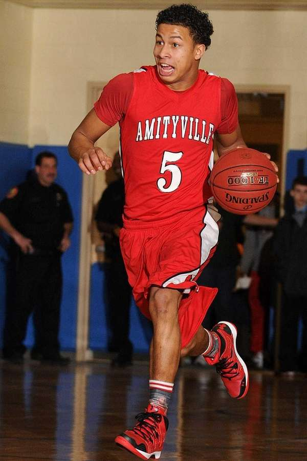 Amityville's Mike Smith dribbles upcourt during the second