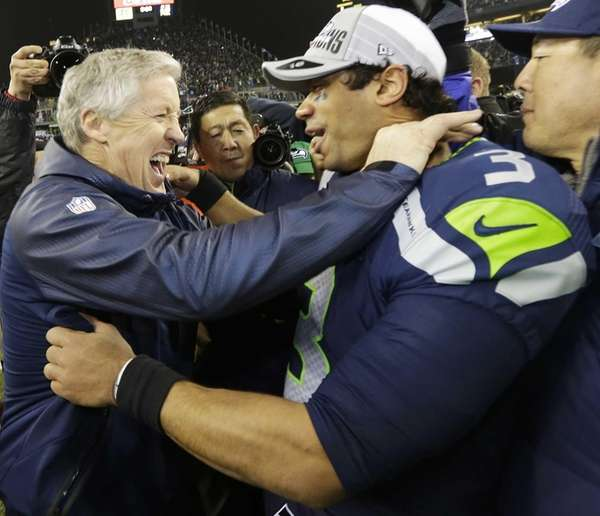 Seattle Seahawks head coach Pete Carroll celebrates with