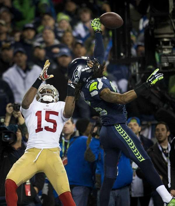 Seattle Seahawks cornerback Richard Sherman (25) hits the