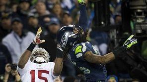 Seattle Seahawks cornerback Richard Sherman (25) hits the