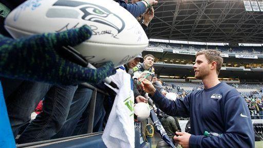Seattle Seahawks kicker Steven Hauschka signs autographs before