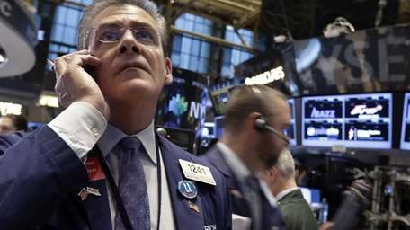 Trader Richard Deviccaro works on the floor of