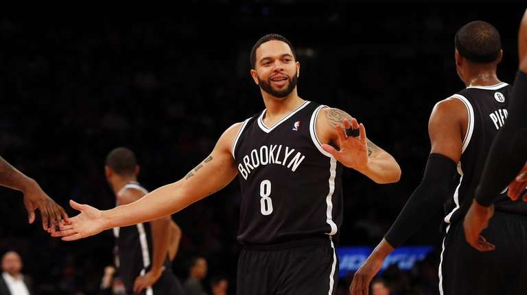 Deron Williams smiles after a play against the