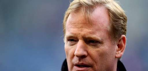 NFL commissioner Roger Goodell on the field on