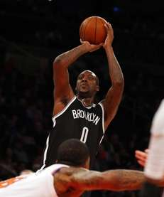 Andray Blatche puts up a shot during a