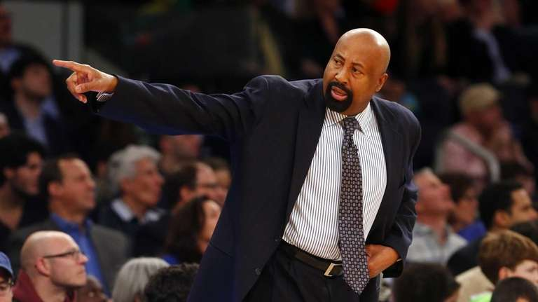 Mike Woodson points to his bench during a