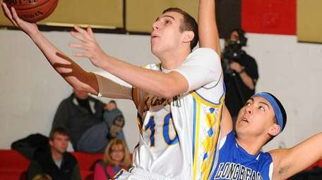Kellenberg's Mike Sullivan, left, drives past Long Beach's
