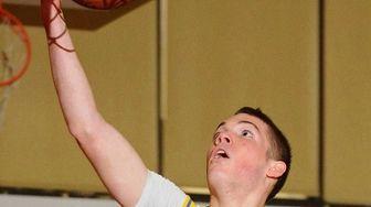 Kellenberg's Steve Torre drives to the basket during
