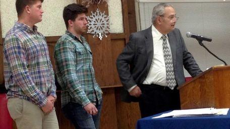 (L-R) Kevin Cox and Michael Cox Jr., sons