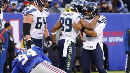 The Seattle Seahawks' Russell Wilson and Doug Baldwin