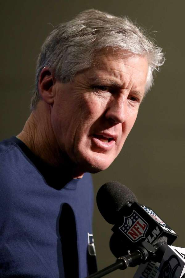Seattle Seahawks head coach Pete Carroll answers questions
