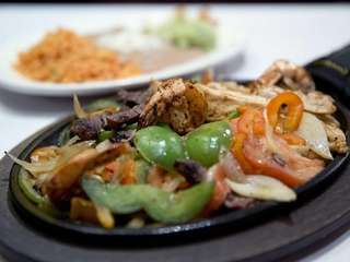The plate of combination fajitas is a Tex-Mex