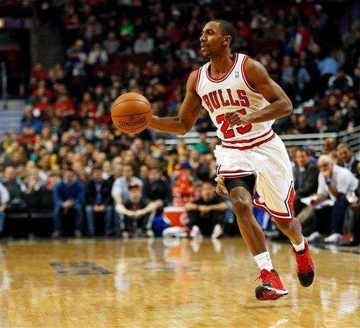 Chicago Bulls guard Marquis Teague brings the ball