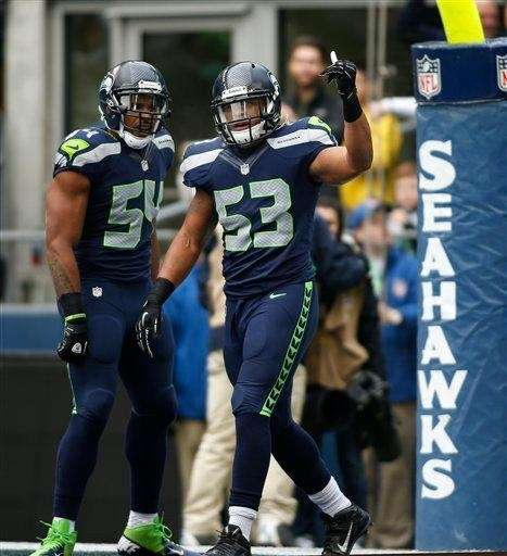 Seattle Seahawks outside linebacker Malcolm Smith (53) celebrates