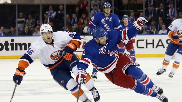 Rick Nash of the Rangers loses his footing