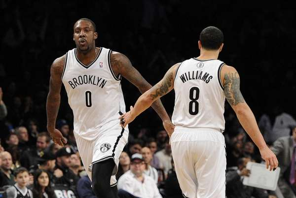 Nets forward/center Andray Blatche reacts after sinking a