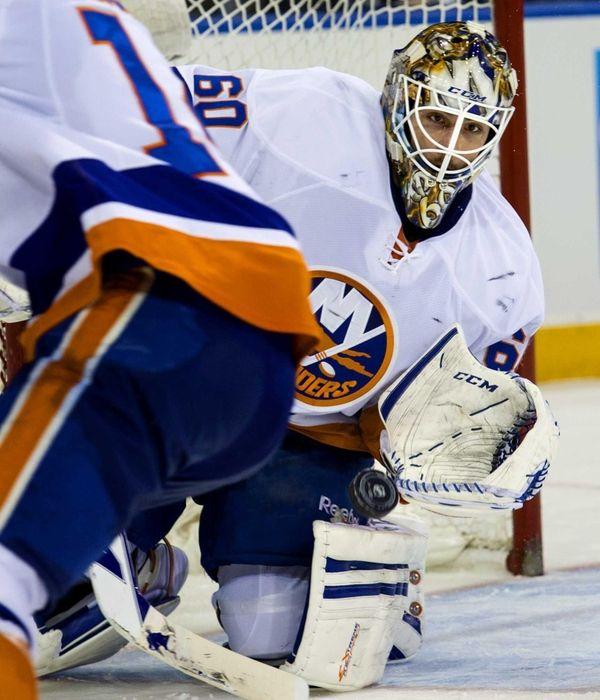 Islanders goalie Kevin Poulin stops a goal in