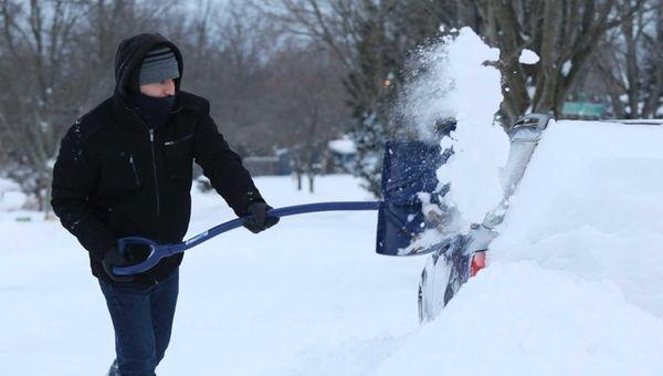 Fernando Leon shovels snow in Stony Brook. (Jan.