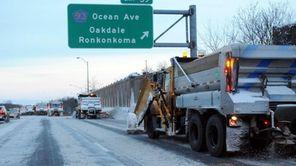 Department of Transportation plow trucks make their way