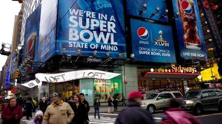 Large signs advertising the Super Bowl are seen
