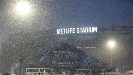 Snow falls over the parking lot of MetLife