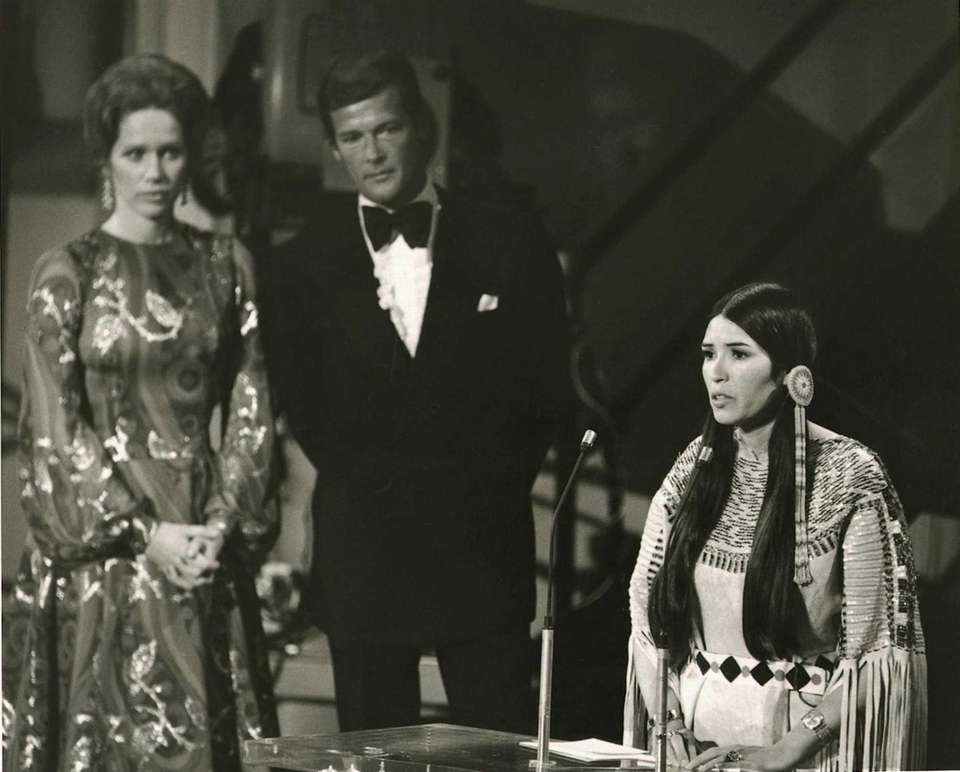 Liv Ullmann and Roger Moore looked on in