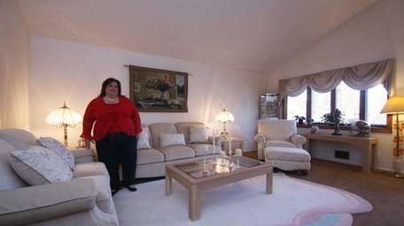 Donna Curcio stands in the living room of