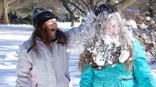 Rachel Propis, 12, smashes a snowball over the