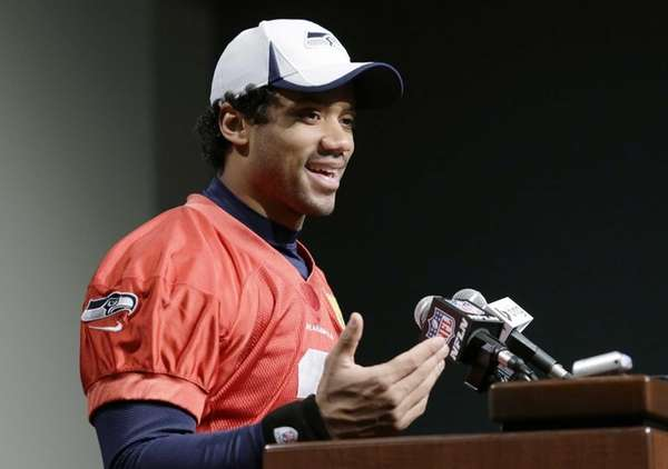 Seattle Seahawks quarterback Russell Wilson speaks at an