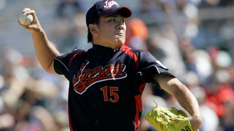 Masahiro Tanaka pitches to the San Francisco Giants