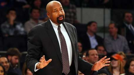Mike Woodson of the Knicks reacts during a