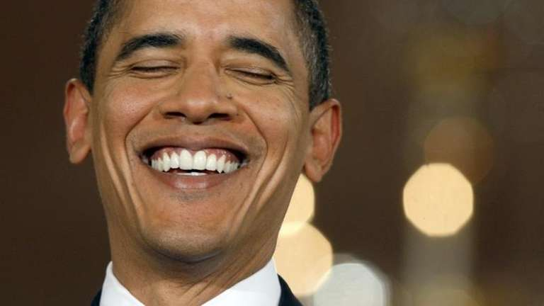 In this file photo, President Barack Obama laughs