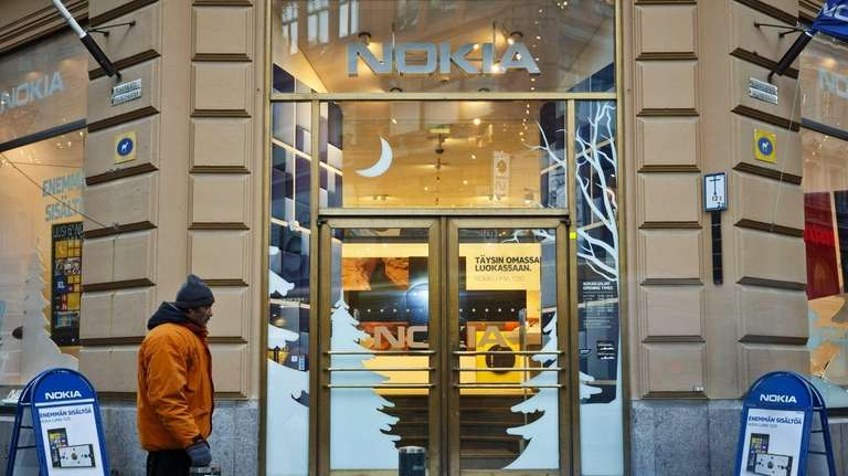 A man passes by the Nokia flagship store