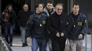 Vincent Asaro is escorted from FBI offices in
