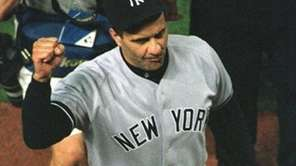 Yankees manager Joe Torre raises his fist as