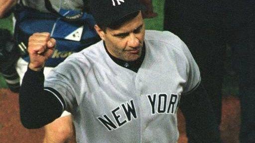 Yankees manager Joe Torre raises his fist as