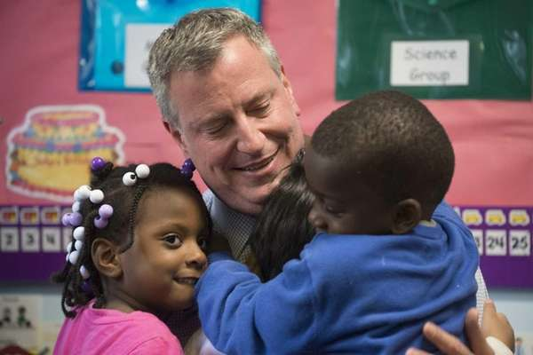 New York City Mayor Bill de Blasio receives