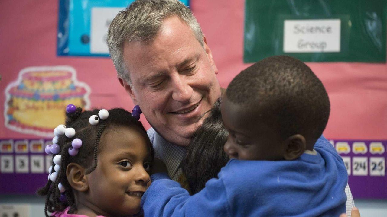 New York City Mayor Bill de Blasio receives