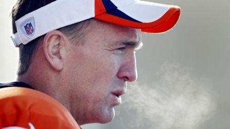 The breath of Denver Broncos quarterback Peyton Manning