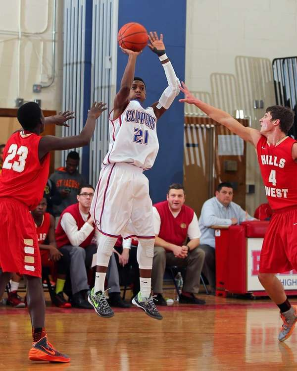 Bellport's Andrew Trent sinks a shot from the