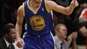 The Golden State Warriors' Stephen Curry points to