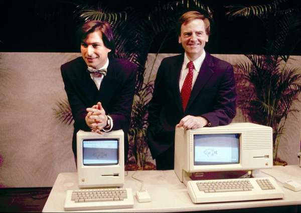 Steve Jobs, left and John Sculley present the