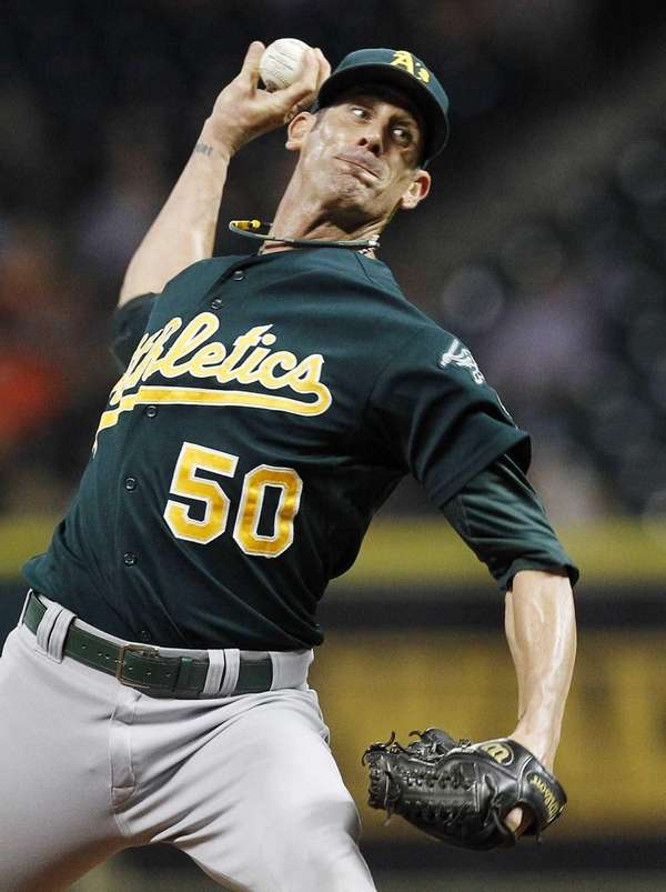 Former Oakland Athletic Grant Balfour delivers a pitch